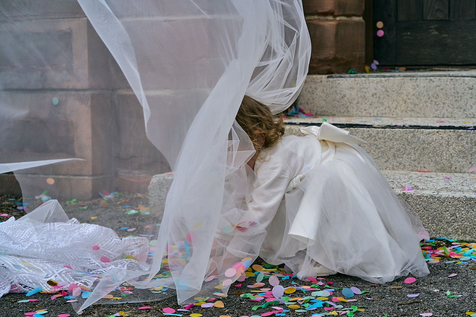 flower girl collects confetti and caught in veil