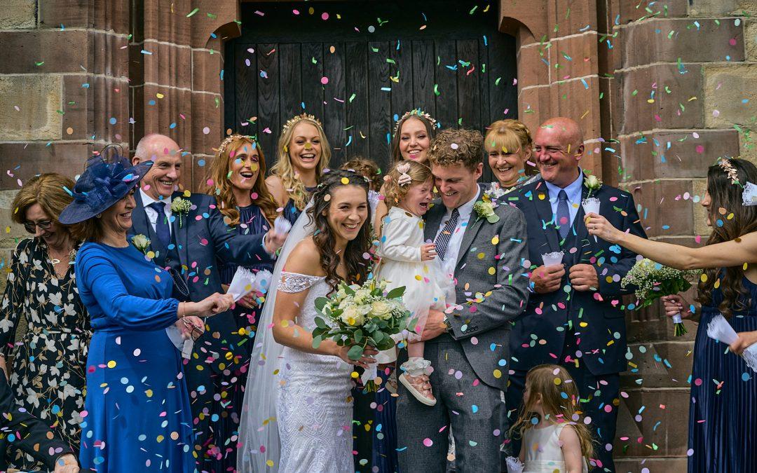 fun confetti wedding photo outside liverpool church