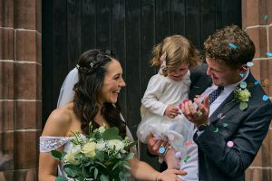 bride and groom with daughter for wedding photographs in liverpool