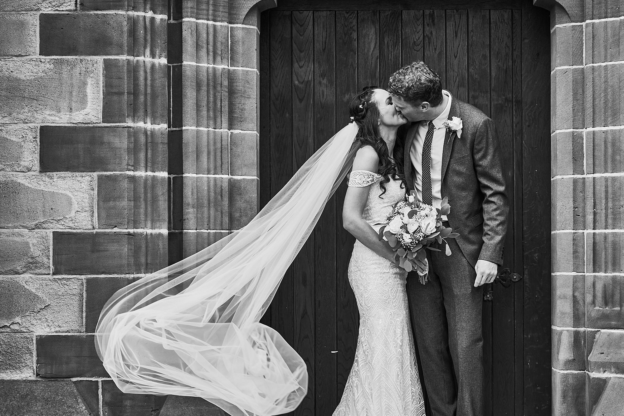 black and white bride and groom unposed portrait liverpool