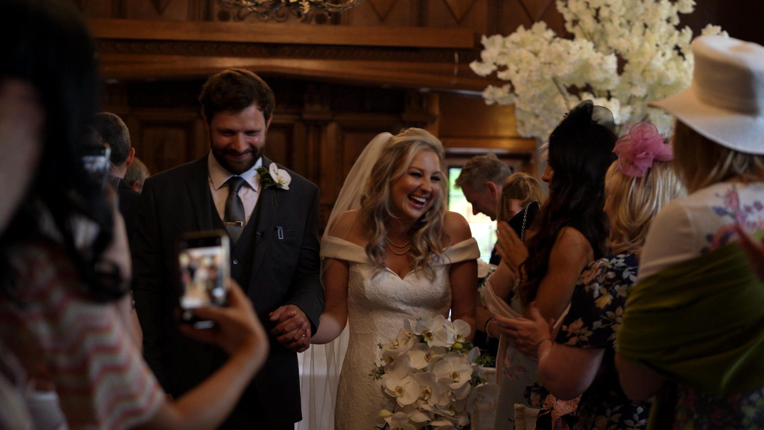 couple walk down aisle at Inglewood manor