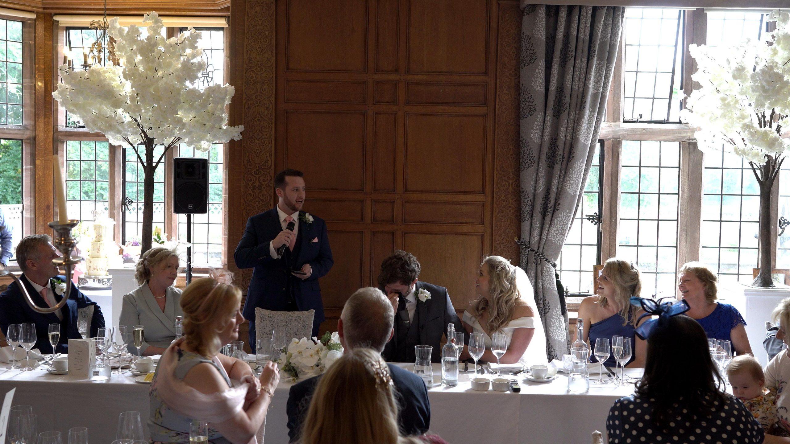 nervous best man stands for wedding speech