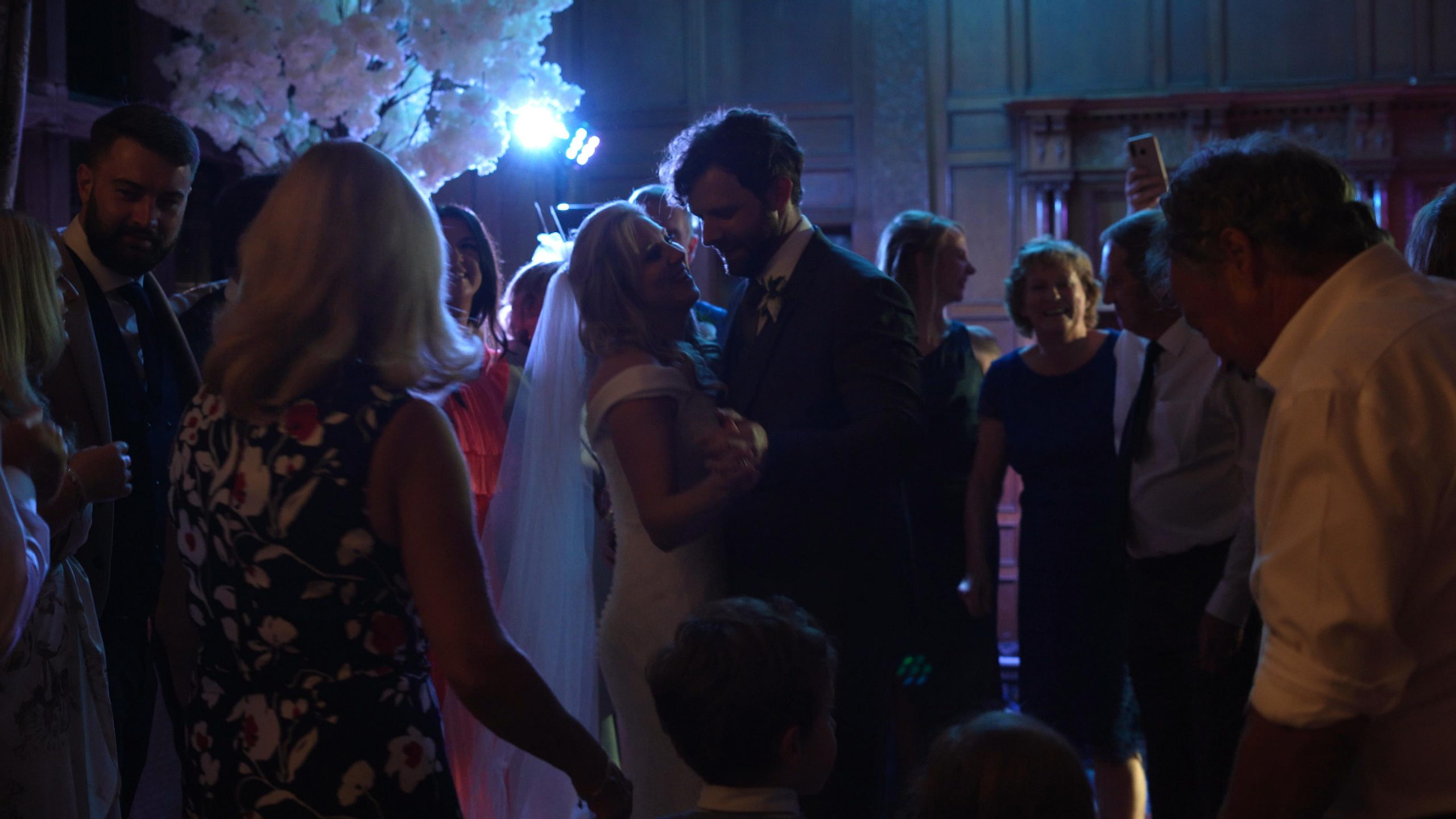 guests crowd around the couple on the dancefloor