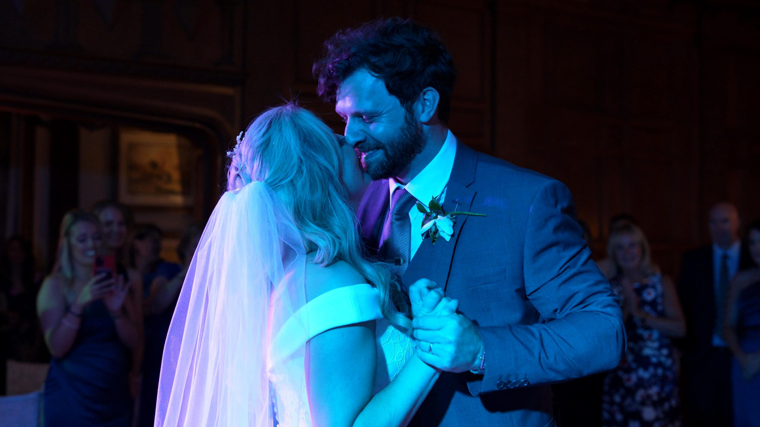 couple smile at each other during first dance