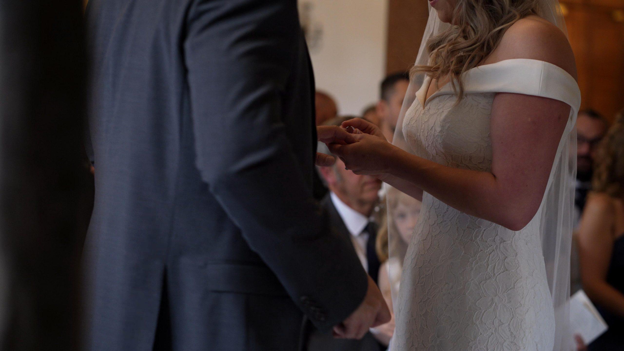 couple exchange wedding rings in cheshire wedding