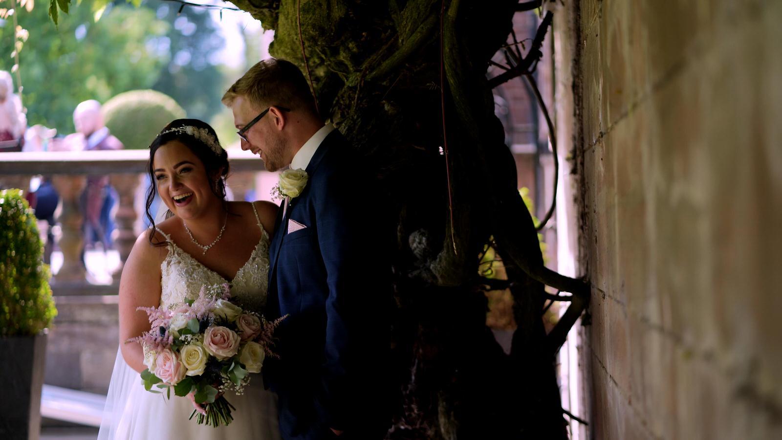 couple laugh during photos at wedding