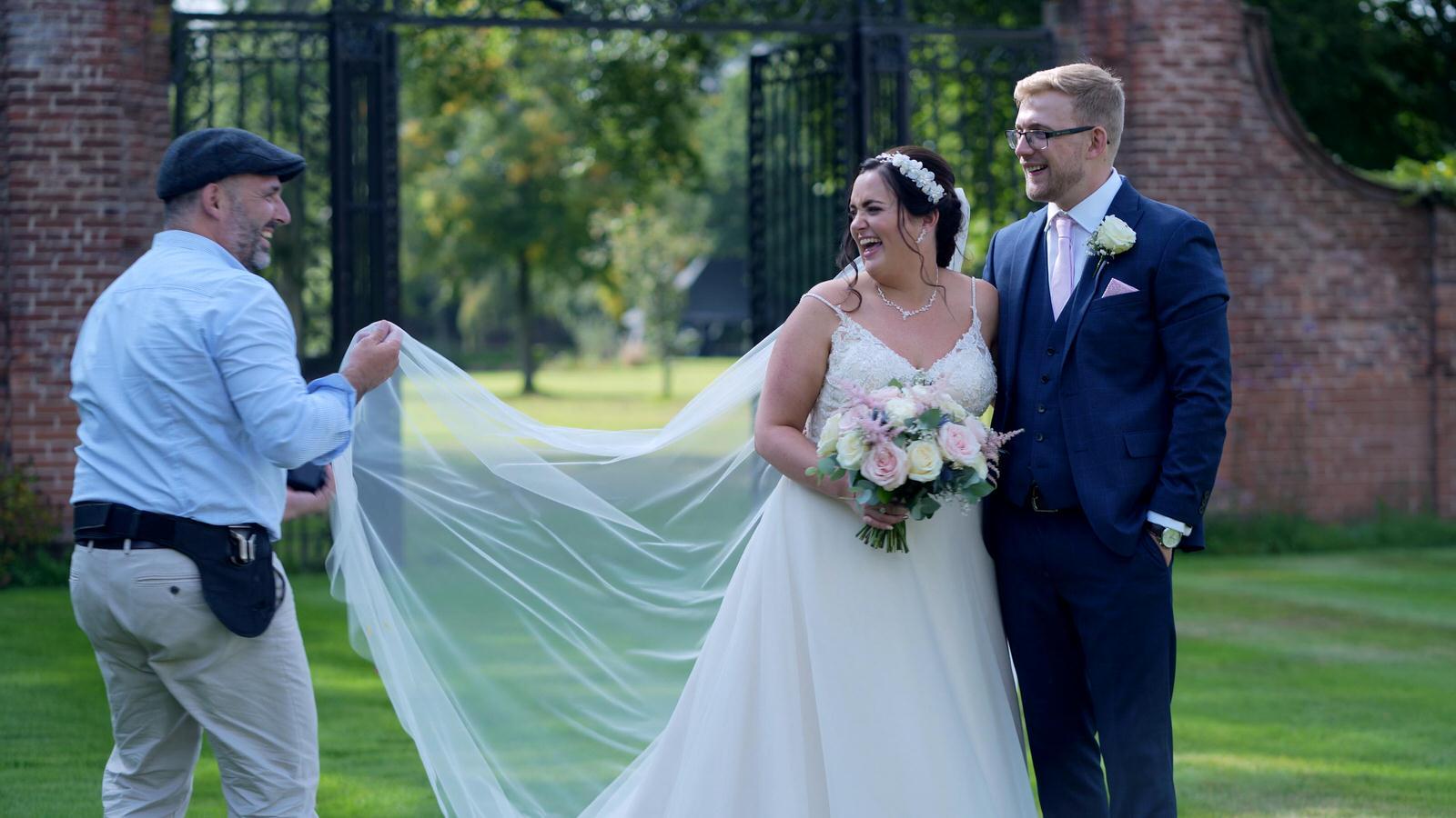 couple laugh with wedding photographer Ioan Said