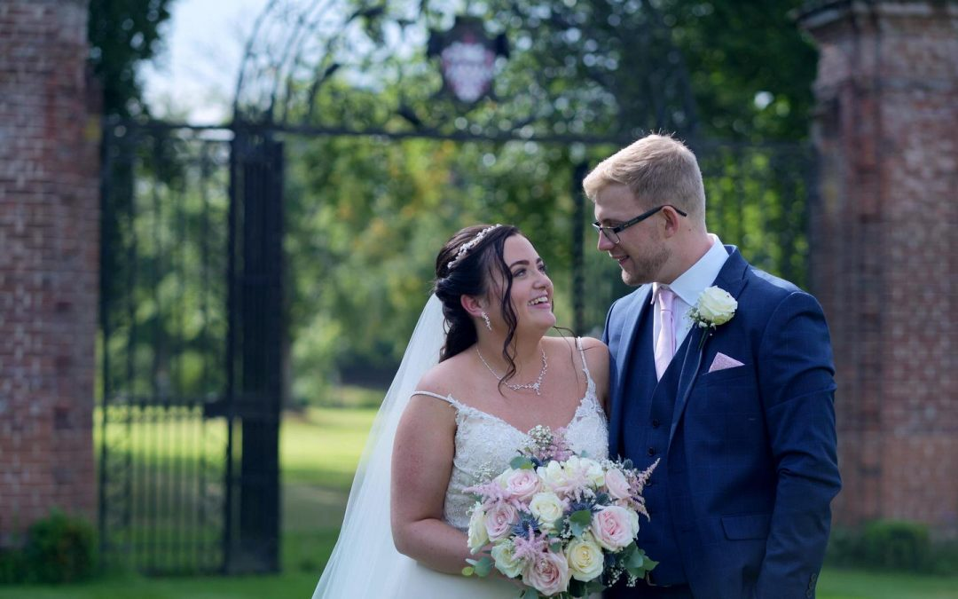 couple smile at each other in Inglewood Manor gardens