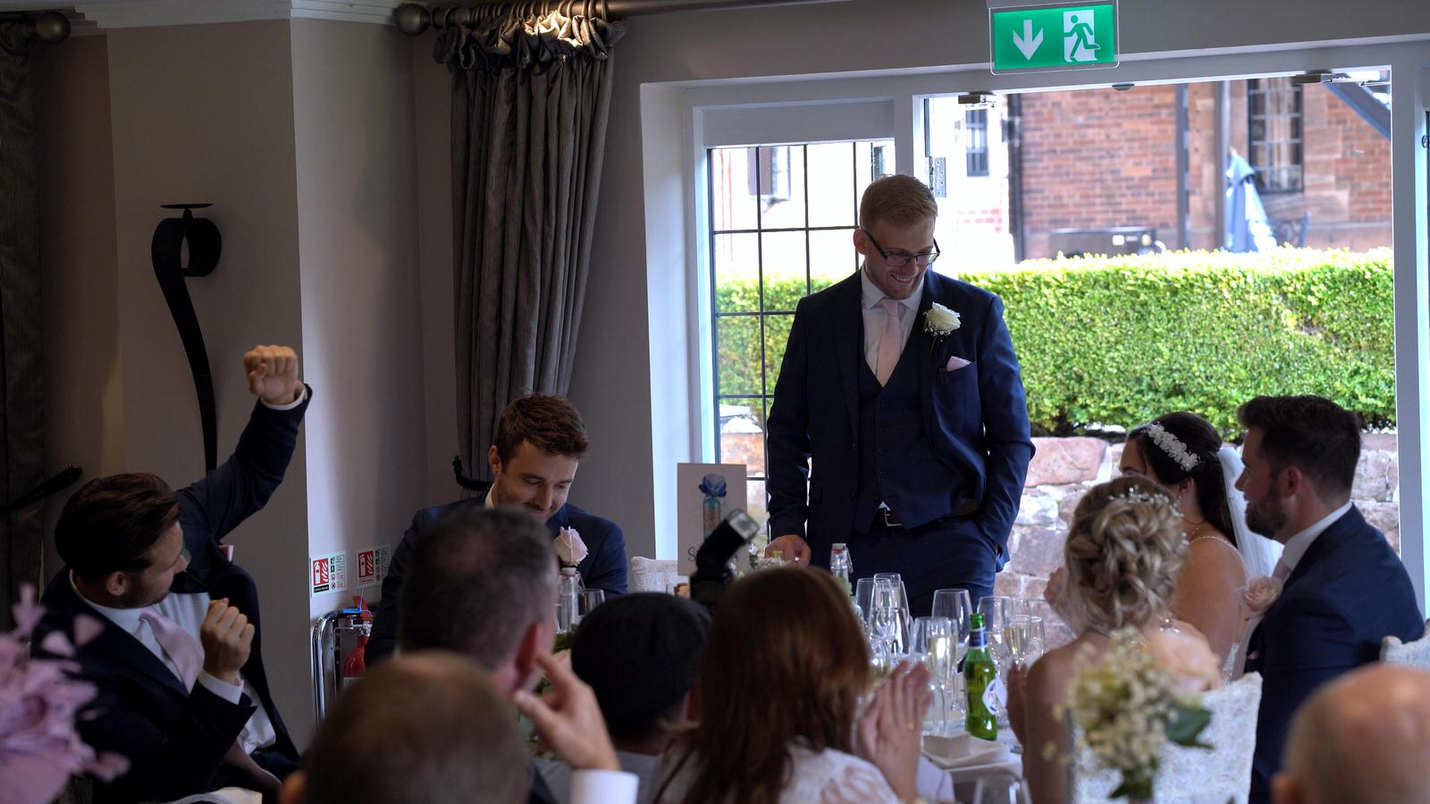 Groom stands for speech at Inglewood Manor