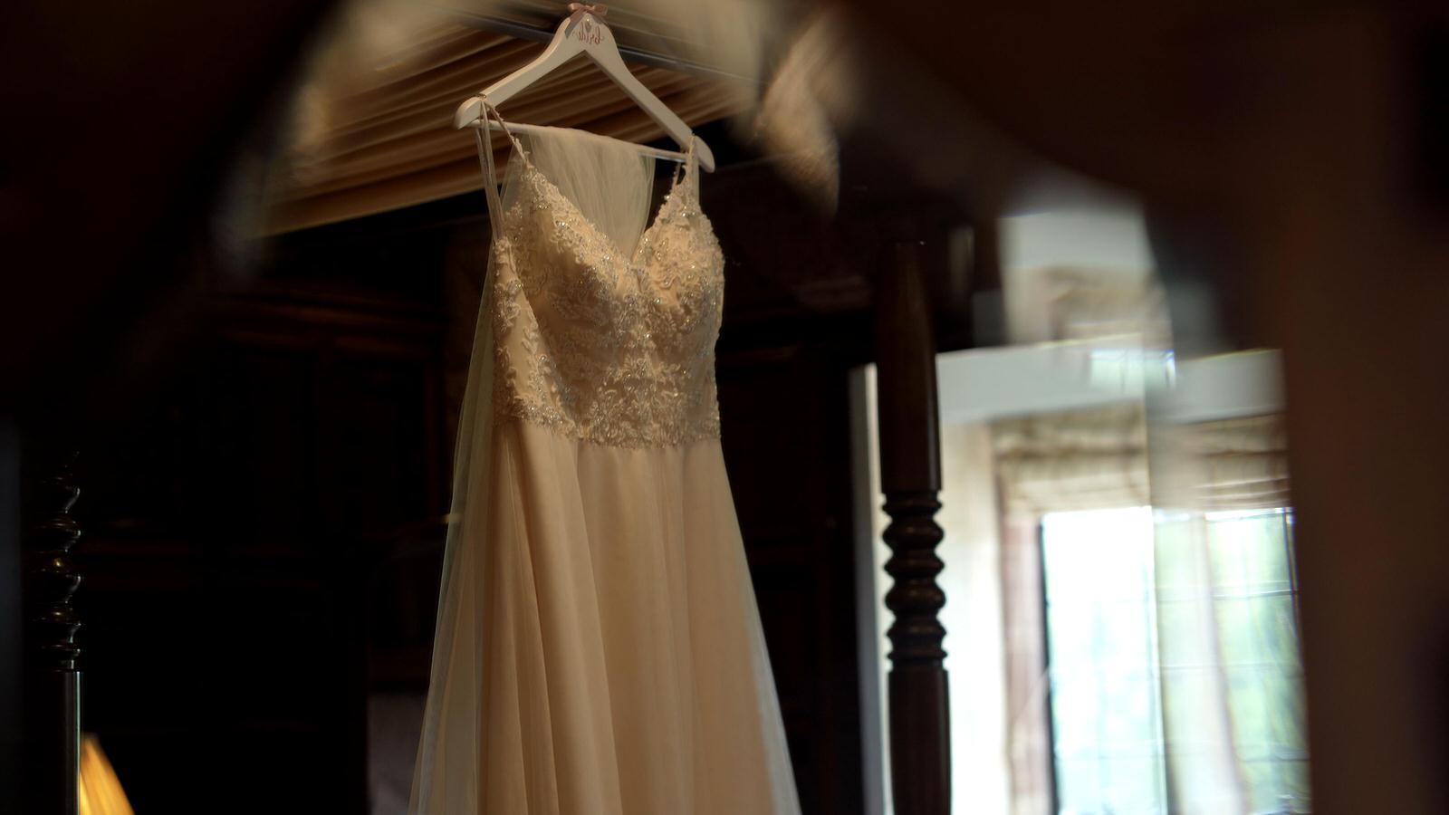 wedding dress hangs in inglewood manor bridal suite