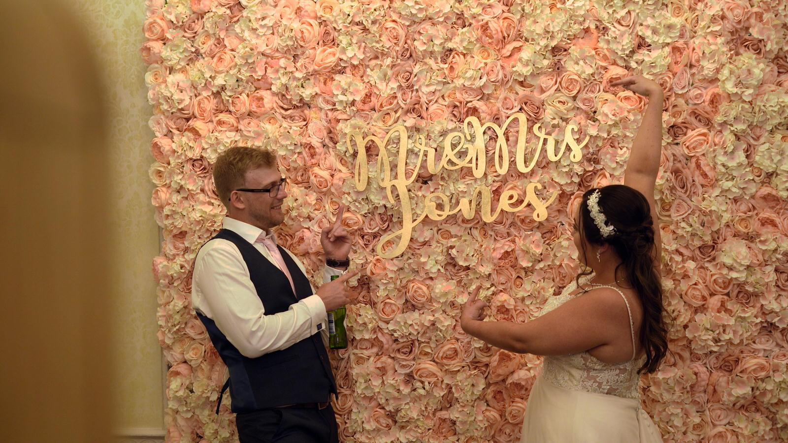 couple pose and point for Lovely Booths photo booth