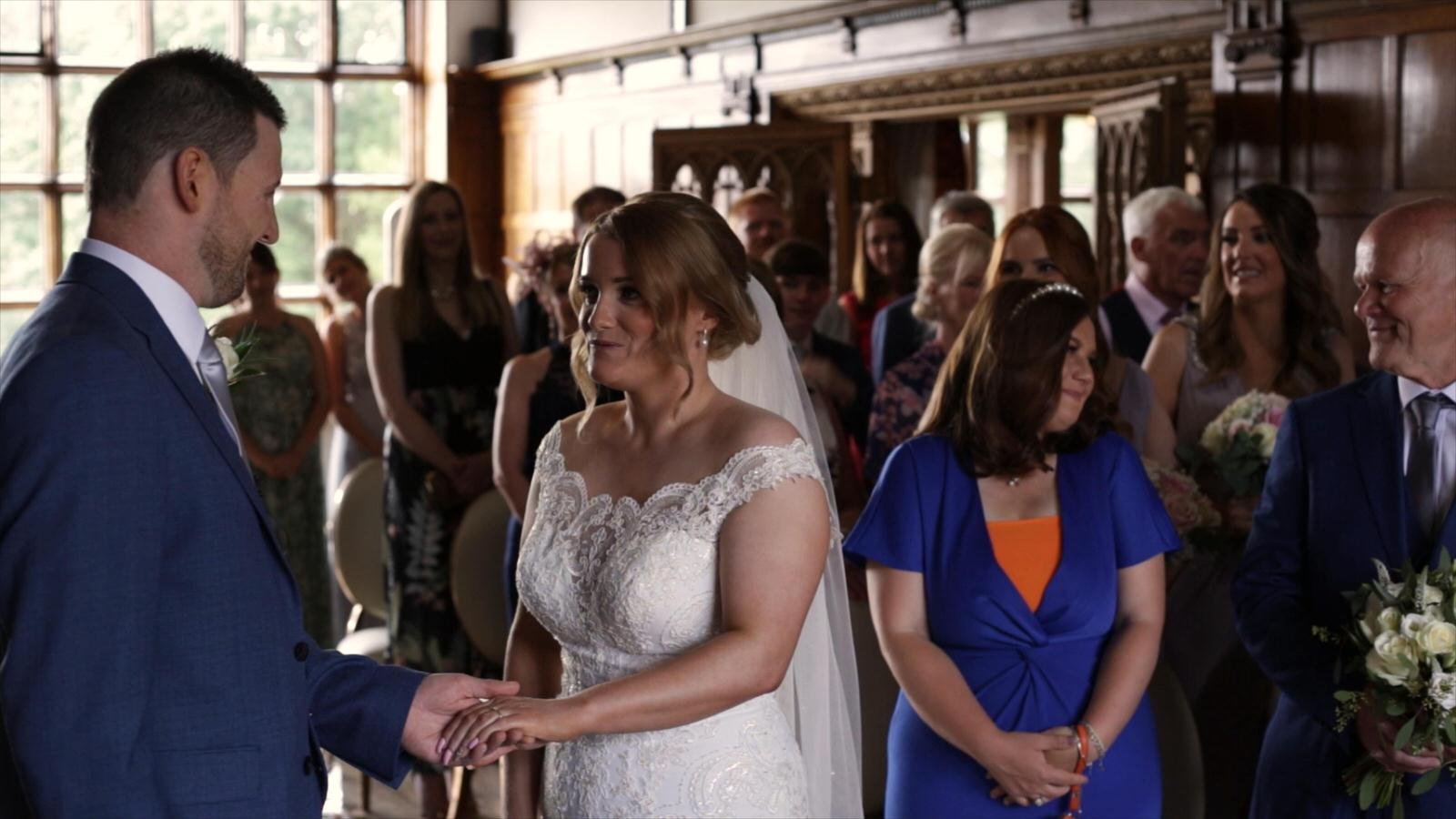 video still of couple exchanging wedding rings at hillbark hotel