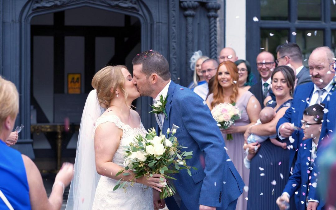 couple kiss during confetti photo and video outside Hillbark